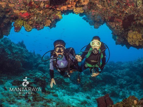 Women divers and beautiful reef in Cozumel